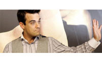 """Kate Moss n'a """"rien fait de mal"""", selon Robbie Williams"""