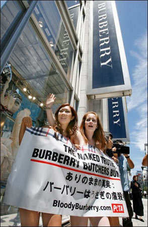 Naked activists march against Burberry use of fur in ...
