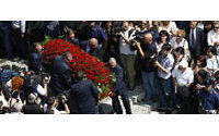 Italian fashion designer Ferre buried in hometown