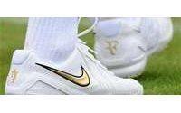 Nike profit up but shares tumble on US concerns