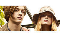 Burberry Q3 tops forecast, to cut 540 jobs