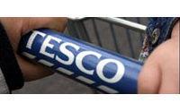 European shares rise; Tesco leads retailers up