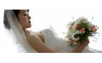 Gold tiaras for rent for recession-hit Japan brides
