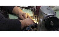 Manos latinas trabajan con empeño en talleres de alta costura