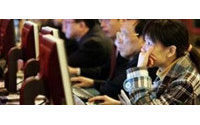 Asia's shoppers go online as Internet barriers fall