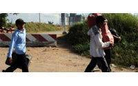 Vietnam's migrant workers return home as downturn bites