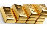 Gold dips on investor confidence, soft dollar aids