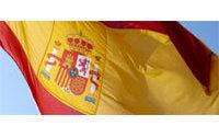 Spanish retail slide eases in April