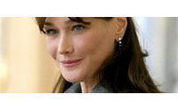 Hats off to Carla: Bruni-Sarkozy beats Queen in hat poll