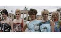 Berlin Wall graffiti returns as leather fashion