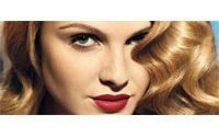 Revlon second quarter profit erodes on charges