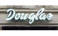 Douglas swings to third quarter pretax loss, keeps outlook
