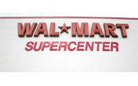 Wal-Mart's flat profit beats estimates, shares up