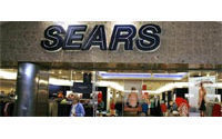 Sears posts surprise loss as housing woes weigh