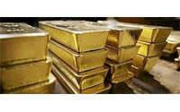Gold price hits record high above 1,058 dollars