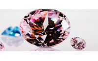 """Vivid pink"" diamond sells for record $10.8 million"