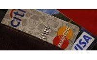 Stores endure new card rules despite hurt profits
