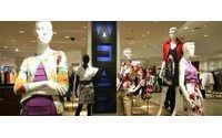 Saks benefits from better economy, TJX slows