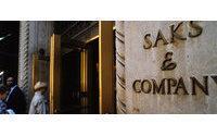 Saks turns a profit, sees higher 2011 sales