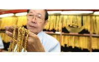 Gold slides as Japan crisis slams markets