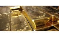 Gold tops $1,500 an ounce for first time
