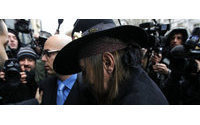 Designer Galliano in legal battle with lawyers