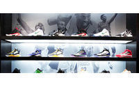 Nike quarterly net income rises 14 percent