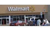 Wal-Mart pays lawyer fees for dozens of execs in bribery probe