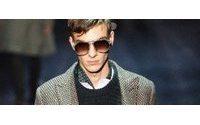 Gucci: sobria y bohemia elegancia para un hombre que usa botas de caña alta