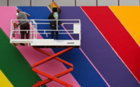 Paul Smith paints iconic pink wall rainbow to celebrate Pride