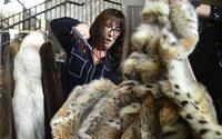 Anjelica Huston cuts up fur coats for PETA
