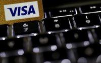 Visa tops profit estimates as consumer spending grows