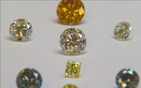 Lab-grown diamond prices slide as De Beers fights back