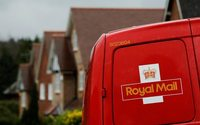 Royal Mail looks to parcels as cuts dividend and lifts investment