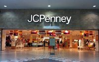 J.C. Penney quarterly loss halves, sales still fall amid turnaround