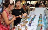 China cuts consumption tax on cosmetics to stir growth