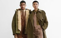 Buoyant Burberry hands back government cash
