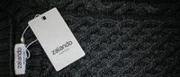 Zalando shrugs off Amazon threat to lift profit forecast