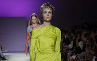Michael Kors to take control of Italy's Versace, say sources