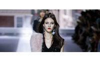 London fashion designers show twist on British summers