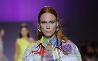 Michael Kors confirms Versace buy, renames itself Capri Holdings