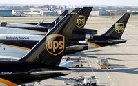 UPS profit hurt by severe weather, issues disappointing outlook for second quarter&#x3B; shares sink