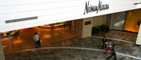 Neiman Marcus' loss narrows as sales rise
