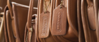 Coach Inc's sales rise for first time in 10 quarters
