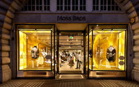 Suit specialist Moss Bros reports sales growth