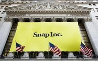 Snap ends down slightly in brisk trade on lockup expiry