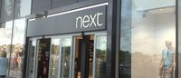 Next raises year profit forecast