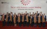 After poncho mockery, world leaders tone it down in Peru with shawls
