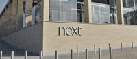 Next raises full-year guidance on strong trading