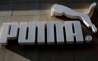 Puma shares tumble as it sticks to profit forecast